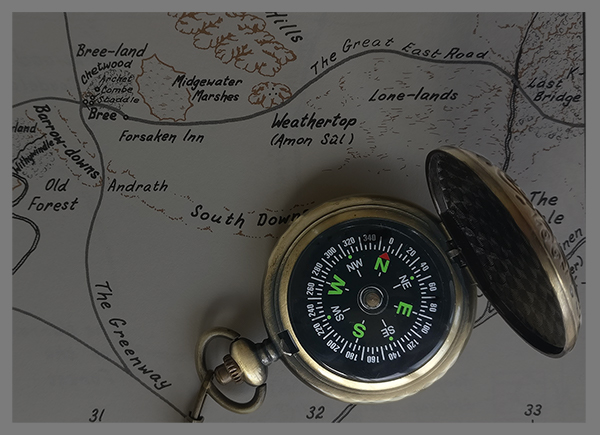 Old compass on map of Middle-Earth by Kai Greenwood